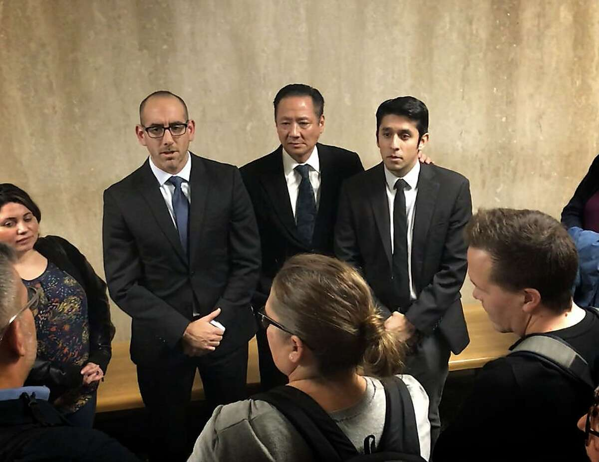Carlos Argueta, pictured right, stands with Public Defender Jeff Adachi, middle, and Assistant District Attorney Adam Maldonado after being acquitted of murder in the 2015 death of a man in San Francisco's South of Market neighborhood.