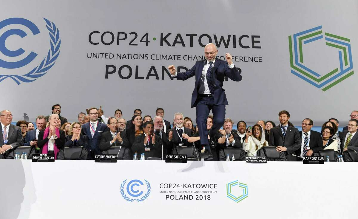 COP24 president Michal Kurtyka jumps at the end of the final session of the COP24 summit on climate change in Katowice, southern Poland, on December 15, 2018. (Photo by Janek SKARZYNSKI / AFP)JANEK SKARZYNSKI/AFP/Getty Images