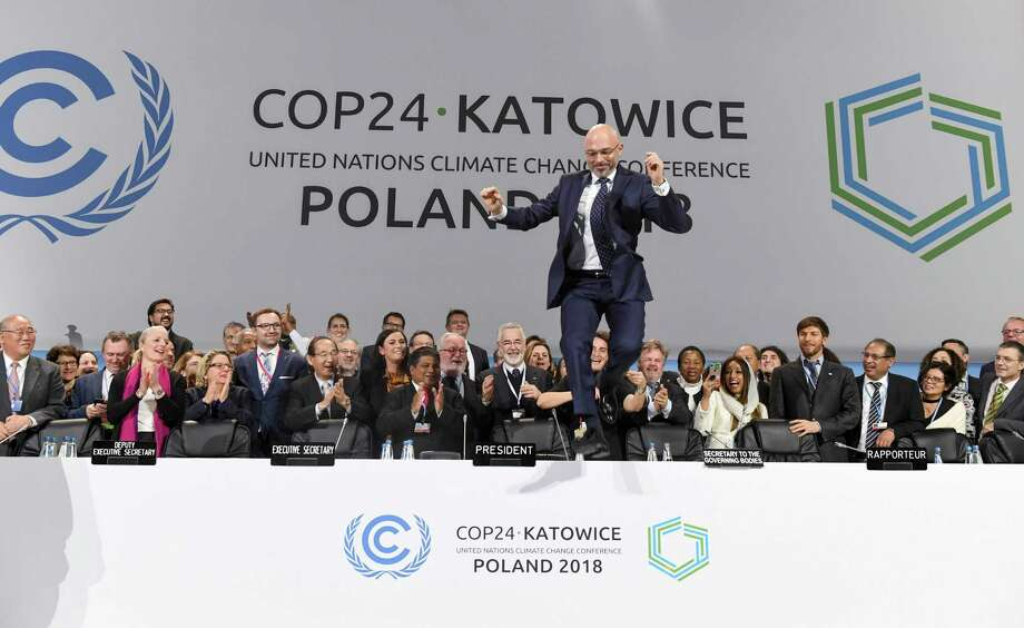 COP24 president Michal Kurtyka jumps at the end of the final session of the COP24 summit on climate change in Katowice, southern Poland, on December 15, 2018. (Photo by Janek SKARZYNSKI / AFP)JANEK SKARZYNSKI/AFP/Getty Images Photo: JANEK SKARZYNSKI / AFP or licensors