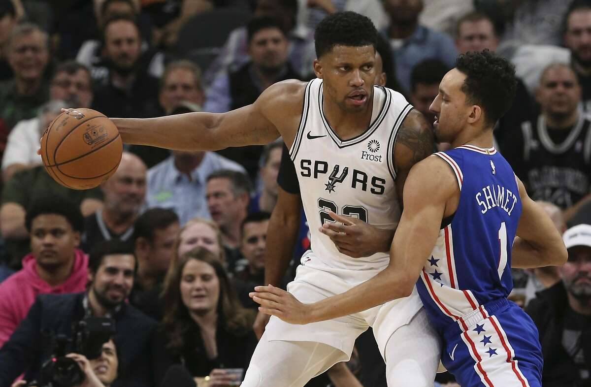 San Antonio Spurs' Rudy Gay keeps the ball away from Philadelphia 76ers' Landry Shamet during the second half at the AT&T Center, Monday, Dec. 17, 2018.