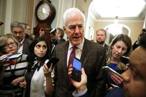 Senate Majority Whip John Cornyn (R-TX) talks to reporters as he heads to vote to begin debate on a bipartisan criminal reform bill, called the 'First Step Act,' at the U.S. Capitol December 17, 2018 in Washington, DC. President Donald Trump said he would sign the legislation, which would reduce the number of inmates in the nations crowded prisons by giving judges more discretion in sentencing offenders for nonviolent crimes and strengthen rehabilitation programs for former prisoners. (Photo by Chip Somodevilla/Getty Images)