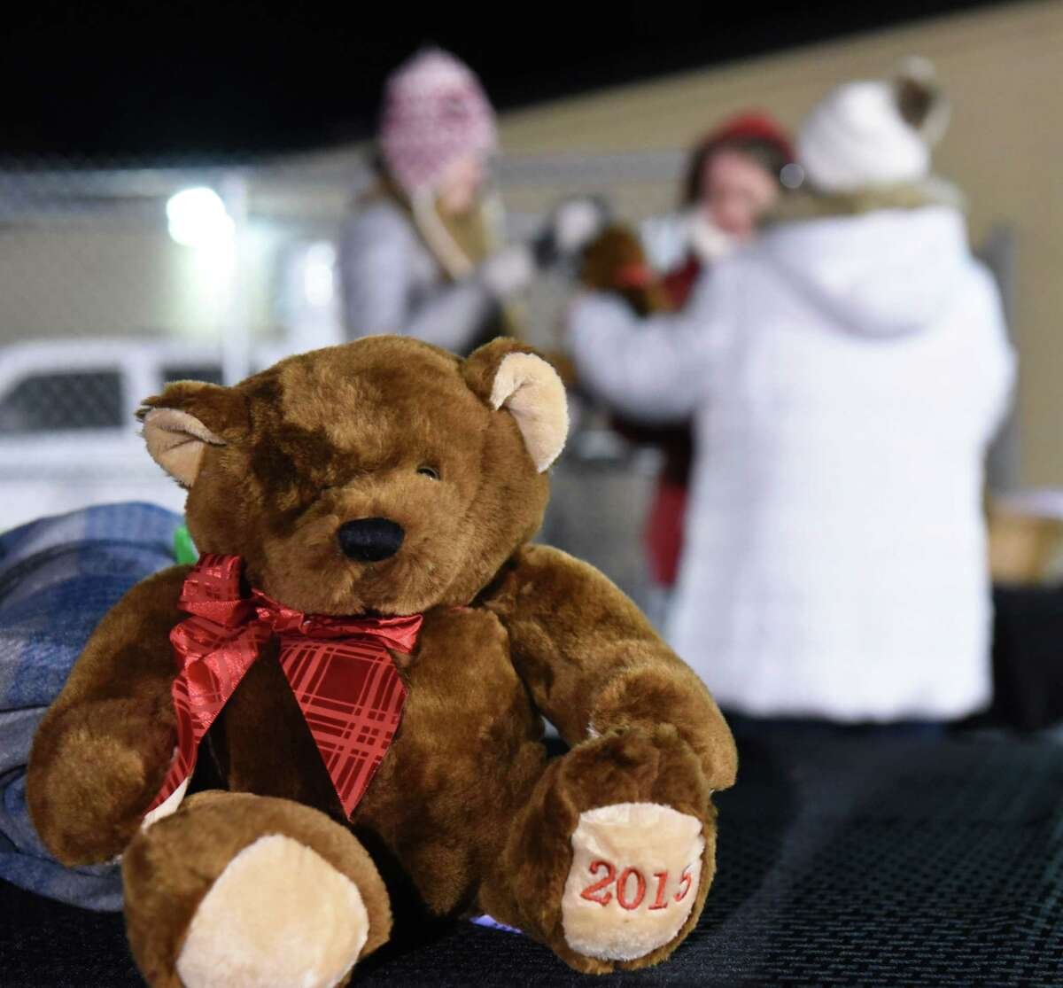 Buddy Blankets & Bears charity hands out blankets and Emma bears to people as they arrive to attend a vigil to honor seventh-grader Emma Jones at the Ballston Spa High School football field on Tuesday, Dec. 18, 2018 in Ballston Spa, N.Y. Jones was killed as part of what police say was a murder-suicide. (Lori Van Buren/Times Union)