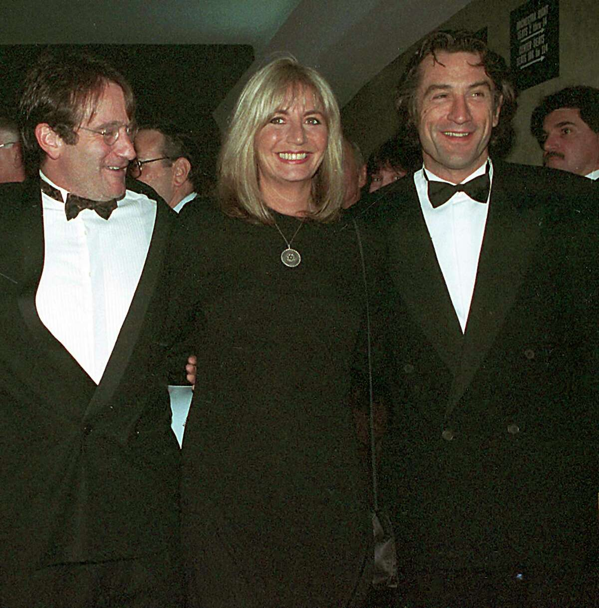 FILE - In this Dec. 17, 1990 file photo, director Penny Marshall poses with co-stars of