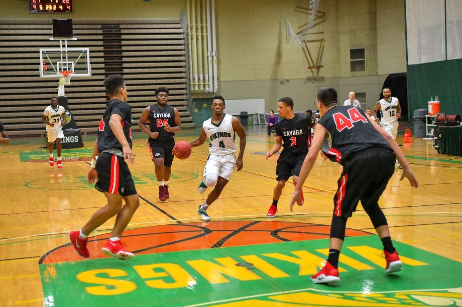 Hudson High School graduate Caleb Canty, center, of the Hudson Valley men's basketball team. (Courtesy of HVCC) Photo: VINCET A GIORDANO / Copyright 2018