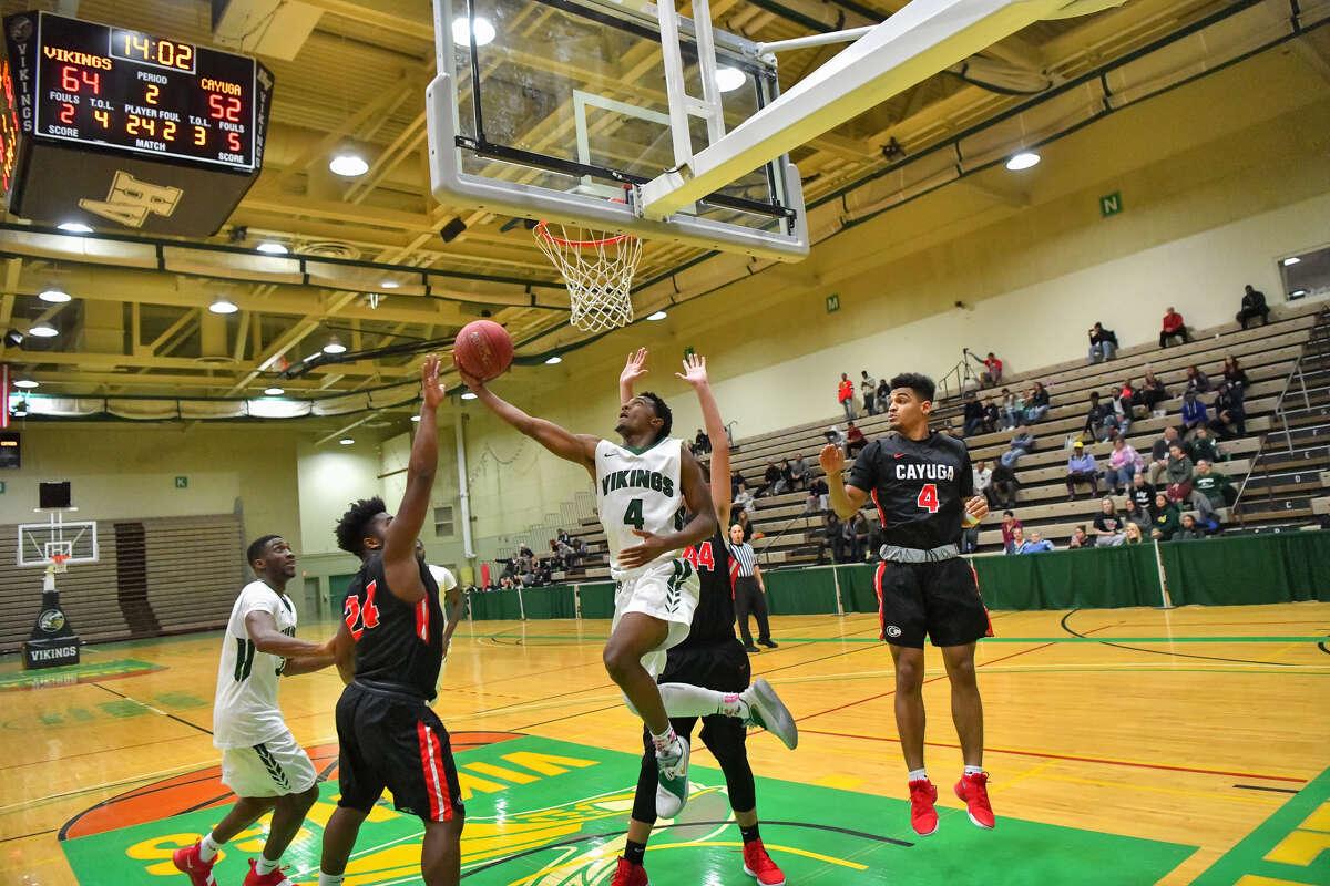 Hudson High School graduate Caleb Canty, center, of the Hudson Valley men's basketball team. (Courtesy of HVCC)