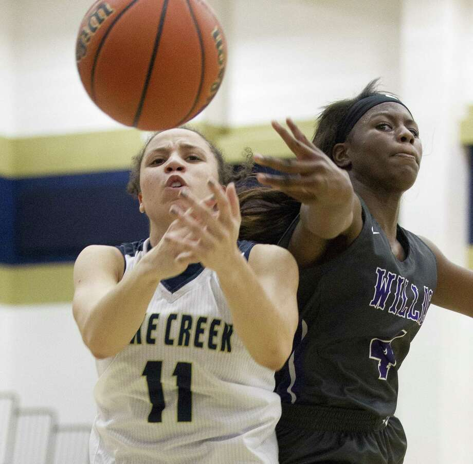 Willis guard TeTe Hollis (4) knocks the ball away from Lake Creek center Jasmine Payne (11) during the second quarter of a District 20-5A high school girls basketball game at Lake Creek High School, Tuesday, Dec. 18, 2018, in Montgomery. Photo: Jason Fochtman, Houston Chronicle / Staff Photographer / © 2018 Houston Chronicle