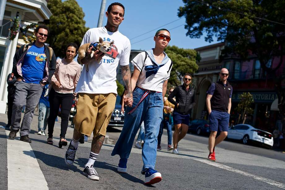Stylist TJ (@bigbaggyjesus) and Analee are photographed in the Haight-Ashbury district wearing a Ben Davis shirt, Us vs. Them socks, Converse shoes (him), and vintage clothes, Nike shoes (Asia exclusive) (her). Photo: Adam Mastroianni / Special To The Chronicle