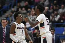 Connecticut's Christian Vital (1) and Connecticut's Sidney Wilson (15) react during the first half of an NCAA college basketball game against Drexel, Tuesday, Dec. 18, 2018, in Hartford, Conn. (AP Photo/Jessica Hill)