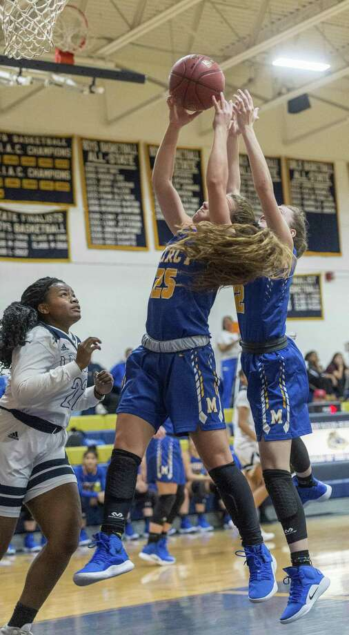Mercy High School's Alessandra Fronc and Lilly Hedge go up to pull down a rebound during a girls basketball game against Notre Dame-Fairfield played at Notre Dame-Fairfield, Fairfield, CT. Tuesday, December 18, 2018. Photo: Mark Conrad / For Hearst Connecticut Media / Connecticut Post Freelance