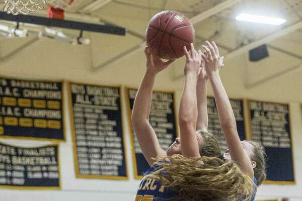 Mercy High School?'s Alessandra Fronc and Lilly Hedge go up to pull down a rebound during a girls basketball game against Notre Dame-Fairfield played at Notre Dame-Fairfield, Fairfield, CT. Tuesday, December 18, 2018.