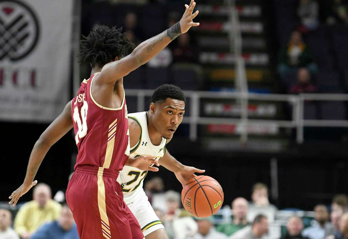 Charleston guard Zep Jasper (10) defends against Siena guard Jalen Pickett (22) in the first half of their NCAA college basketball game in Albany, N.Y., Tuesday, Dec. 18, 2018.