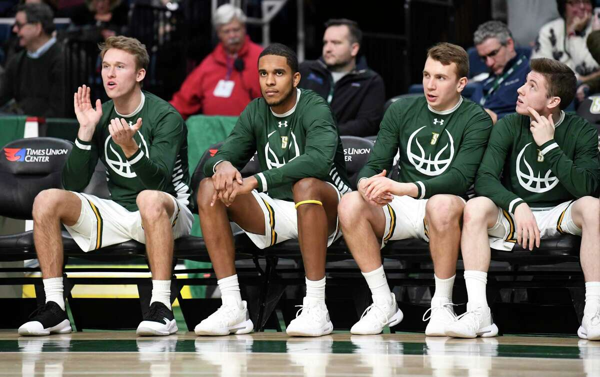 Siena Denzel Tchougangn, second from left, cheers teammates against Charleston the first half of an NCAA college basketball game in Albany, N.Y., Tuesday, Dec. 18, 2018. Charleston won the game 83-58.