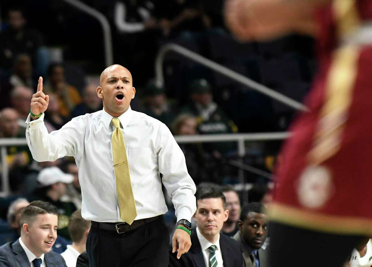 Siena head coach Jamion Christian instructs his players against Charleston in the first half of an NCAA college basketball game in Albany, N.Y., Tuesday, Dec. 18, 2018. Charleston won the game 83-58.