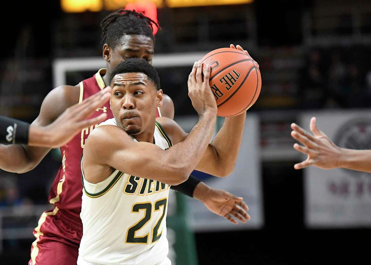 Siena guard Jalen Pickett (22) moves the ball against Charleston in the first half of an NCAA college basketball game in Albany, N.Y., Tuesday, Dec. 18, 2018. Charleston won the game 83-58.