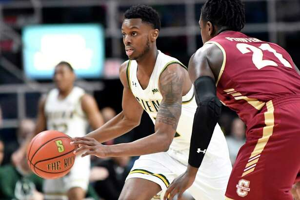 Siena guard Kadeem Smithen (5) moves the ball against Charleston Cougars guard Marquise Pointer (21) NCAA college basketball game in Albany, N.Y., Tuesday, Dec. 18, 2018. Charlston won the game 83-58.