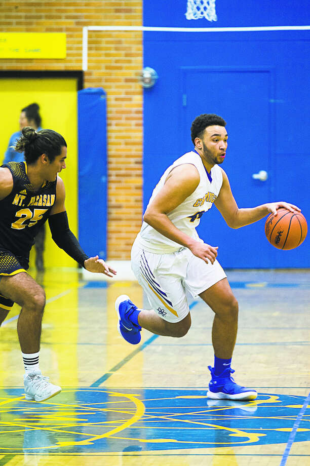 Midland High's Isaiah Bridges brings the ball upcourt during a game against Mount Pleasant earlier this season. Photo: Daily News File Photo