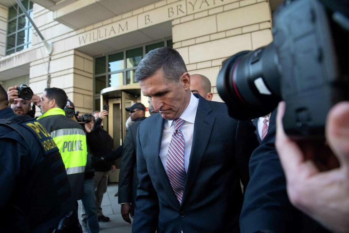 Former National Security Advisor General Michael Flynn leaves after the delay in his sentencing hearing at US District Court in Washington, DC, December 18, 2018. - President Donald Trump's former national security chief Michael Flynn received a postponement of his sentencing after an angry judge threatened to give him a stiff sentence. Russia collusion investigation head Robert Mueller had proposed Flynn receive no jail time for lying to investigators about his Moscow ties. But Judge Emmet Sullivan said Flynn had behaved in a