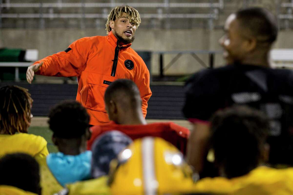 Houston Texans free safety Tyrann Mathieu answers questions as he visits with the Fort Bend Marshall football team following their practice at Hall Stadium on Tuesday, Dec. 18, 2018, in Missouri City. Mathieu was inspired to visit with the team after learning one of their teammates, Drew Conley, was shot and killed last week during a family dispute. Marshall plays Aledo on Friday at AT&T Stadium in Arlington for the Class 5A state championship.