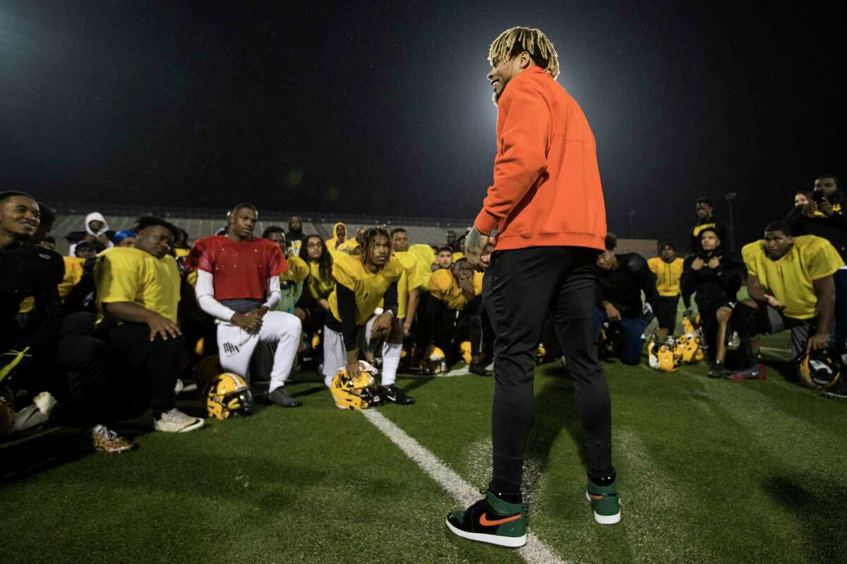 Houston Texans free safety Tyrann Mathieu visits with the Fort Bend Marshall football team following their practice at Hall Stadium on Tuesday, Dec. 18, 2018, in in Missouri City. Mathieu was inspired to visit with the team after learning one of their teammates, Drew Conley, was shot and killed last week during a family dispute. Marshall plays Aledo on Friday at AT&T Stadium in Arlington for the Class 5A state championship.