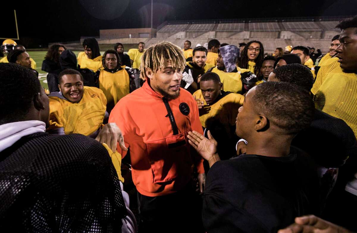 Texans free safety Tyrann Mathieu visits with the Fort Bend Marshall football team following their practice at Hall Stadium on Tuesday, Dec. 18, 2018, in Sugar Land.