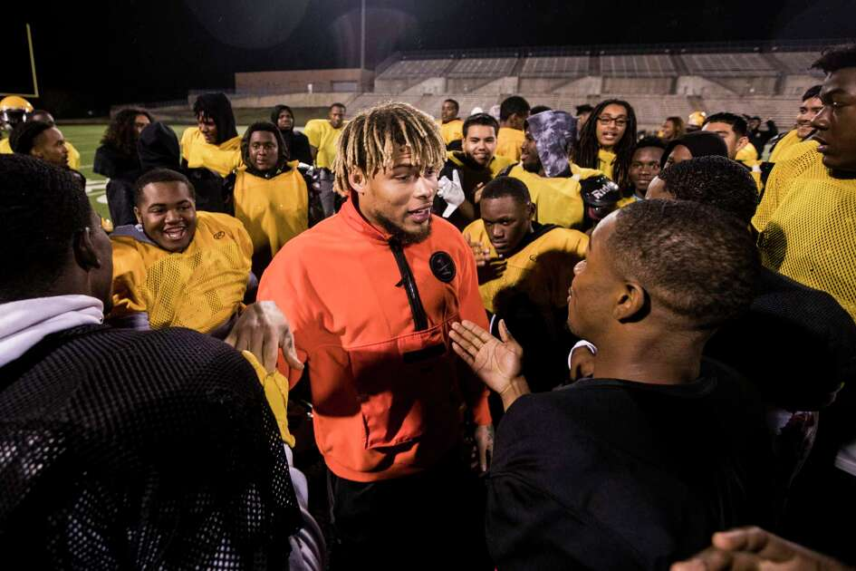 Houston Texans free safety Tyrann Mathieu visits with the Fort Bend Marshall football team following their practice at Hall Stadium on Tuesday, Dec. 18, 2018, in Houston. Mathieu was inspired to visit with the team after learning one of their teammates, Drew Conley, was shot and killed last week during a family dispute. Marshall plays Aledo on Friday at AT&T Stadium in Arlington for the Class 5A state championship.