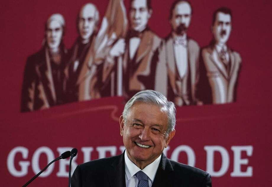 El presidente Andrés Manuel López Obrador, sonríe durante una conferencia de prensa para explicar su reducción de salarios en el Palacio Nacional, en la Ciudad de México, el 18 de diciembre de 2018. Photo: Foto De Cortesía /Presidencia De México /Daniel Aguilar / AFP or licensors