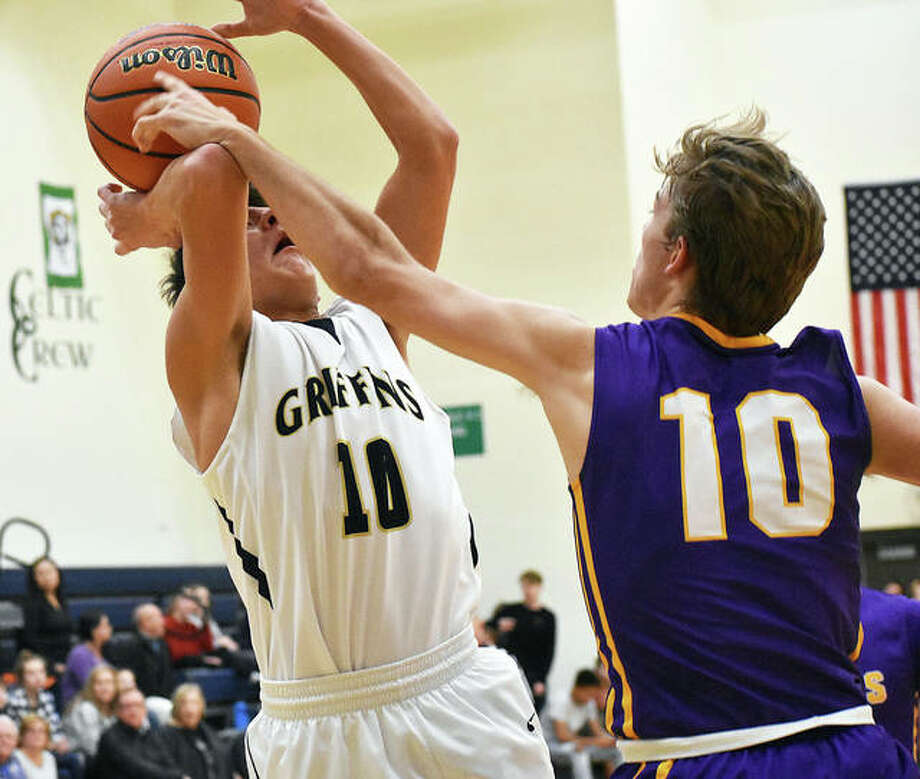Father McGivney's Andrew Dupy has his shot blocked by Civic Memorial's Bryce Zupan in the second quarter of Tuesday's game in Glen Carbon. Photo: Matt Kamp/Intelligencer
