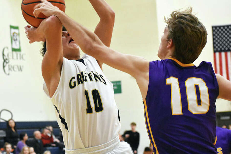 Father McGivney's Andrew Dupy has his shot blocked by Civic Memorial's Bryce Zupan in the second quarter of Tuesday's game in Glen Carbon.