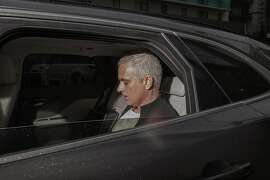 Manchester United former manager Jose Mourinho leaves the Lowry Hotel in Manchester, England, Tuesday, Dec. 18, 2018. Jose Mourinho was fired by Manchester United on Tuesday after failing to restore its status as a major European force in a turbulent 2½-year spell marked by clashes with players and increasing disgruntlement at the team's style of play. (AP Photo/Jon Super)