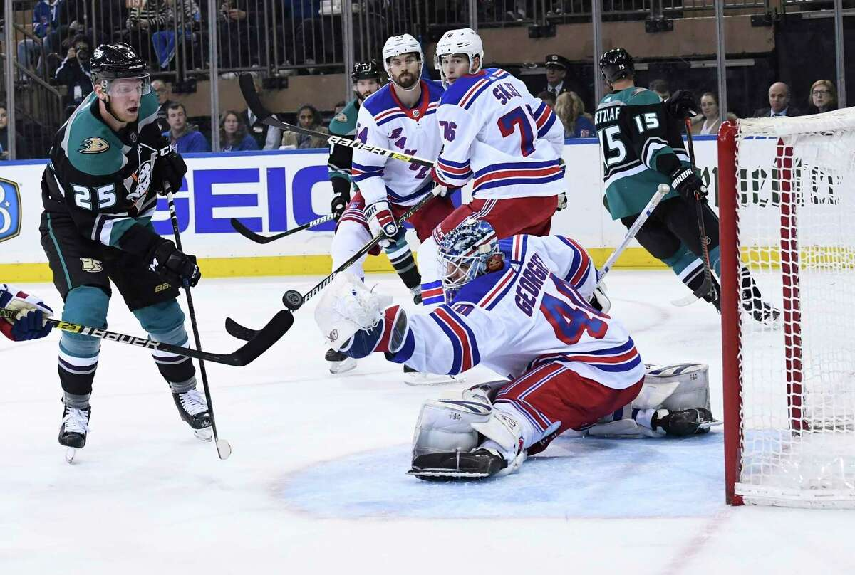 New York Rangers goaltender Alexandar Georgiev deflects the puck as Anaheim Ducks right wing Ondrej Kase looks for a rebound during the second period of an NHL hockey game, Tuesday, Dec. 18, 2018 in New York. (Kathleen Malone-Van Dyke/Newsday via AP)