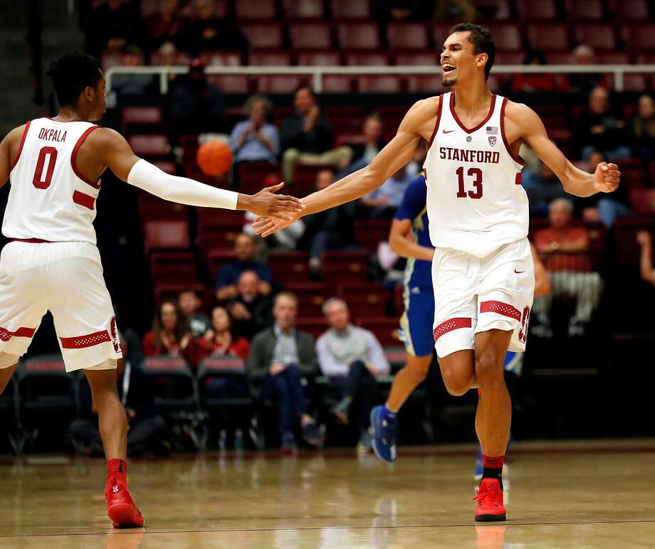 Stanford's Oscar da Silva celebrates one of his 3-pointers with KZ Okpala in 2nd half of Cardinal's 78-73 win over San Jose State in Men's college basketball at Maples Pavilion in Stanford, Calif. on Tuesday, December 18, 2018. Photo: Scott Strazzante / The Chronicle