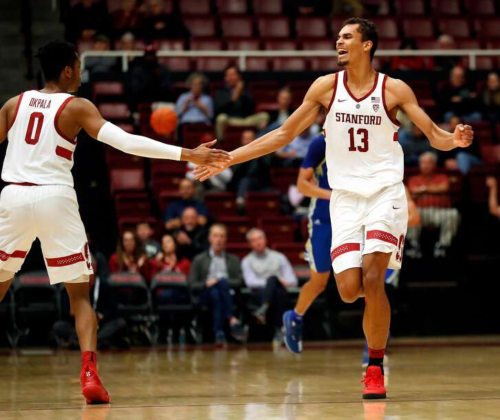 Stanford's Oscar da Silva celebrates one of his 3-pointers with KZ Okpala in 2nd half of  Cardinal's 78-73 win over San Jose State in Men's college basketball at Maples Pavilion in Stanford, Calif. on Tuesday, December 18, 2018.