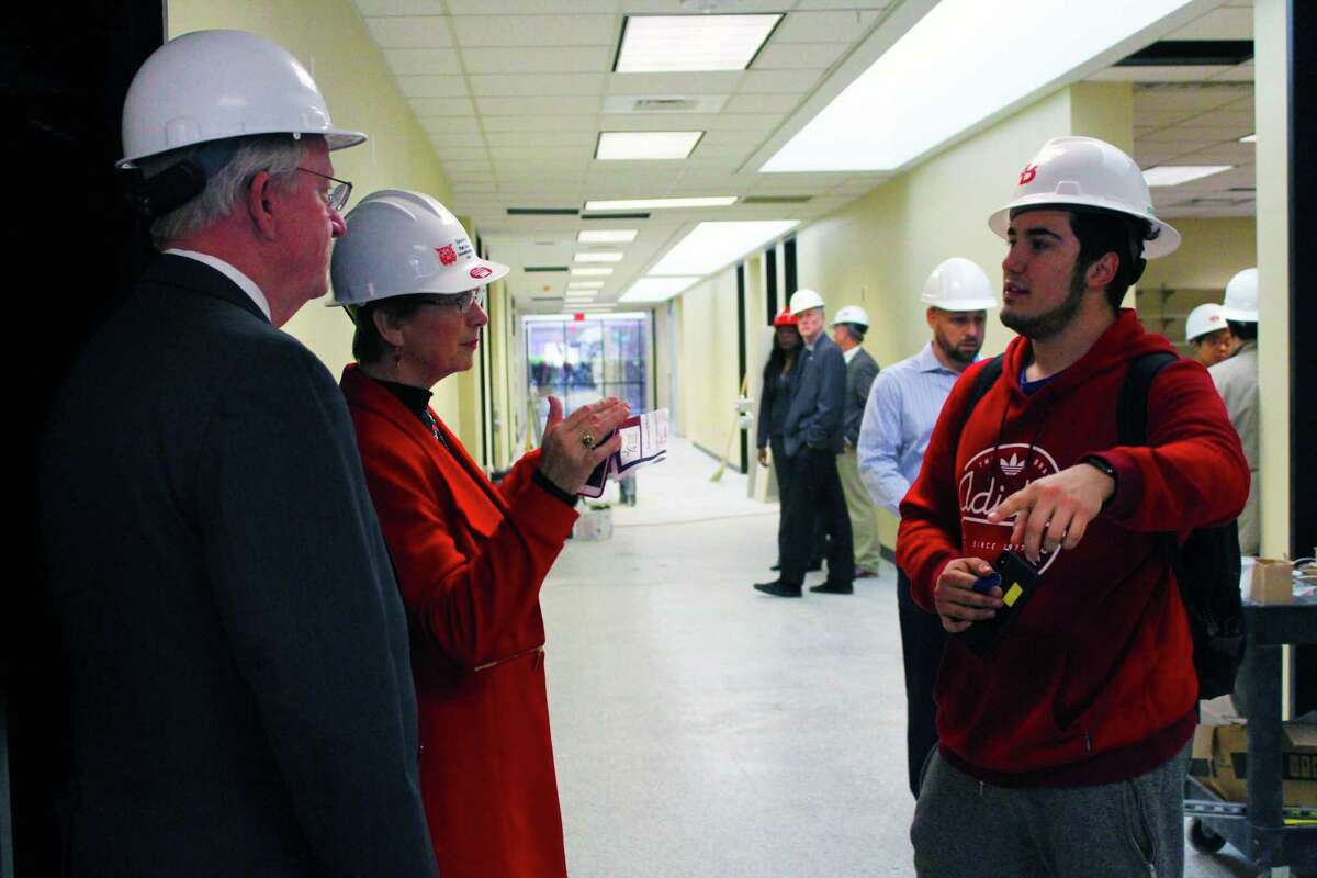 LSC Kingwood President Katerine Persson and District 8 LSC Board of Trustee Mike Sullivan speak with LSC engineering student Nicolas Oviedo about the new engineering room on campus.