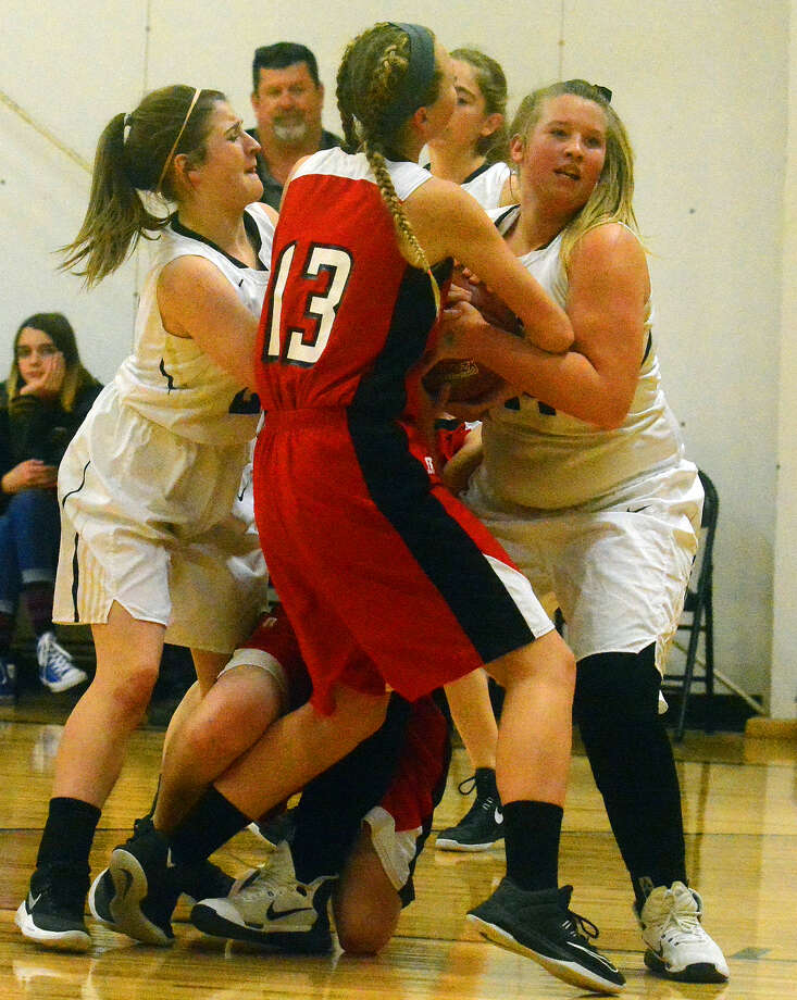 Cotton Center's Kenzie Knippa (left) and Lexi Teaff (right) battle with Southland Lady Eagle Trea Peterson for possession of the ball during Tuesday's girls basketball game in Cotton Center. Photo: Alexis Cubit/Plainview Herald