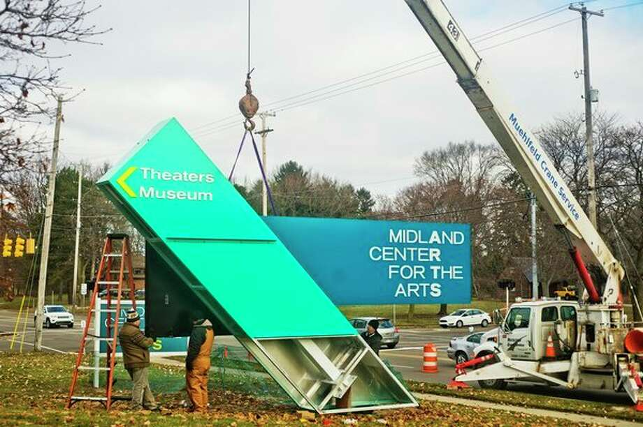 A brand new sign for the Midland Center for the Arts featuring two large LED monitors is installed Tuesday afternoon. The sign was designed by Empire Architectural Design, which is based in Midland. (Katy Kildee/kkildee@mdn.net)