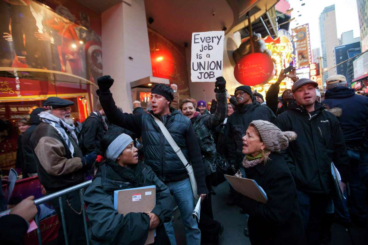 FILE -- Demonstrators protest outside a McDonald's in in New York, Nov. 29, 2012. Labor unions are working in collaboration with social justice activists and other community groups, hoping they will offer them a new opportunity to help raise the floor for wages and working conditions of minimum wage workers. (Michael Nagle/The New York Times)