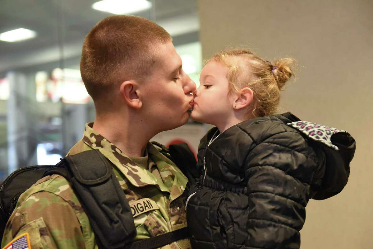 Holiday travel is getting underway early this year. Keep clicking for more photos of Christmastime in the Capital Region through the years. From the archives: Christopher Madigan kisses his niece Alexis Madigan, 2, of Melrose after arriving home at the Albany International Airport on Tuesday, Dec. 20, 2016 in Colonie, N.Y.