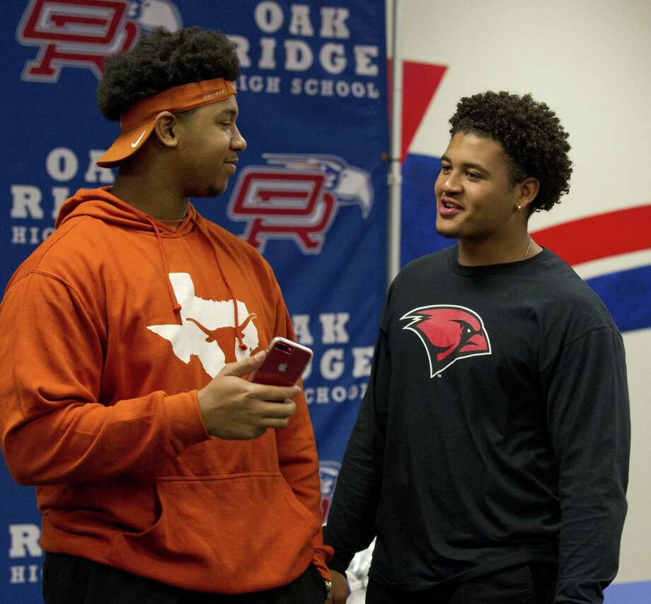 Oak Ridge's Tyler Johnson, left, visits with Darius Richmond during a signing ceremony at Oak Ridge High School, Wednesday, Dec. 19, 2018, in Oak Ridge. Johnson signed to play football for Texas, while Richmond signed with Incarnate Word. Photo: Jason Fochtman, Houston Chronicle / Staff Photographer / © 2018 Houston Chronicle