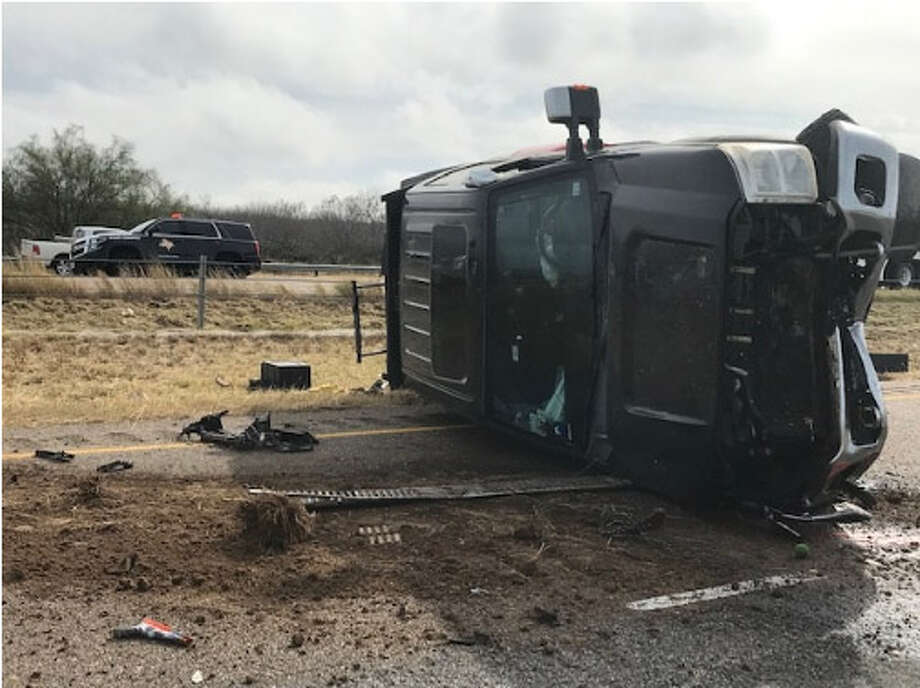 A Ford F-250 landed on its side following a deadly three-vehicle crash reported on mile marker 25 of Interstate 35. The driver of the Ford was taken to a Laredo hospital for treatment. A San Antonio man driving a Honda Civic was pronounced dead at the scene, DPS said. Photo: Courtesy