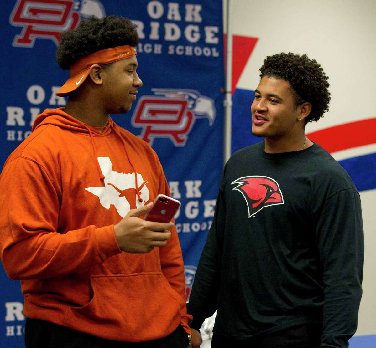 Oak Ridge's Tyler Johnson, left, visits with Darius Richmond during a signing ceremony at Oak Ridge High School, Wednesday, Dec. 19, 2018, in Oak Ridge. Johnson signed to play football for Texas, while Richmond signed with Incarnate Word.