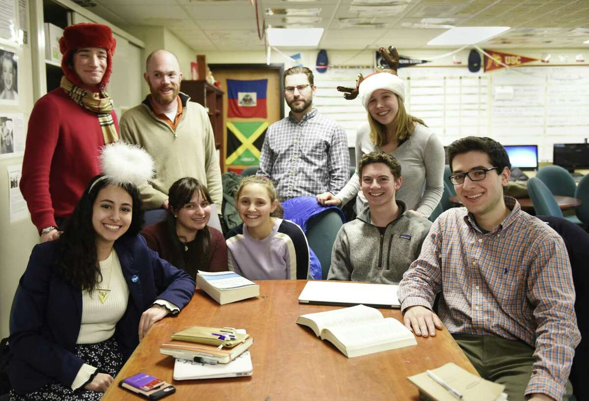 Left to right, top row, Connection Time News Producer John Bolognino, Round Table Co-Advisor Jon Ringel, Round Table Co-Advisor Ryan Hough, Radio Producer Sydney Rubin, and bottom row, Co-Editor In Chief Isabella Sorial, News Editor Emma Sharma, Co-Editor In Chief Shayna Druckman, Multimedia Editor Sam Diamond, and Opinions Editor Matthew Dattolo pose together while working on The Round Table student newspaper after school at Stamford High School in Stamford, Conn. Tuesday, Dec. 18, 2018. The online news publication was recently awarded gold medal status by the Columbia Scholastic Press Association.