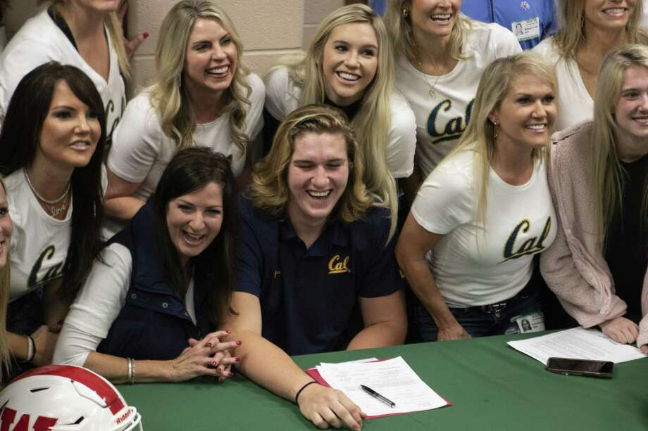 The Woodlands High School senior McKade Mettauer'breaks out into laughter after several attempts for his family and friends to sit still for a photo had failed Wednesday, Dec. 19, 2018 at The Woodlands High School. He signed a commitment to the University of California, Berkeley. Photo: Cody Bahn, Houston Chronicle / Staff Photographer / © 2018 Houston Chronicle