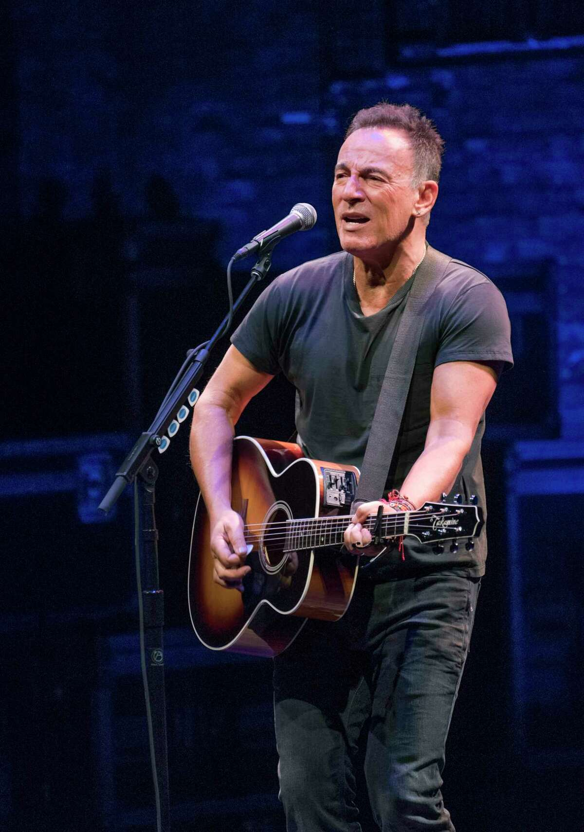 """Bruce Springsteen performs in """"Springsteen on Broadway,"""" his solo concert run at the Walter Kerr Theater in New York, Oct. 5, 2017. Netflix is releasing a film version of the show on Dec. 16, 2018, the day after the last live performance; the entire run was sold out far in advance and tickets for the last show are running for as much as $40,000 each."""