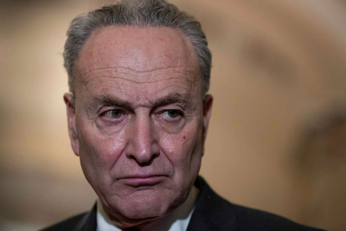 Senate Minority Leader Chuck Schumer, D-N.Y., speaks to reporters about the possibility of a partial government shutdown, at the Capitol in Washington, Tuesday, Dec. 18, 2018. Congress and President Donald Trump continue to bicker over his demand that lawmakers fund a wall along the U.S.-Mexico border, pushing the government to the brink of a partial shutdown at midnight Friday.