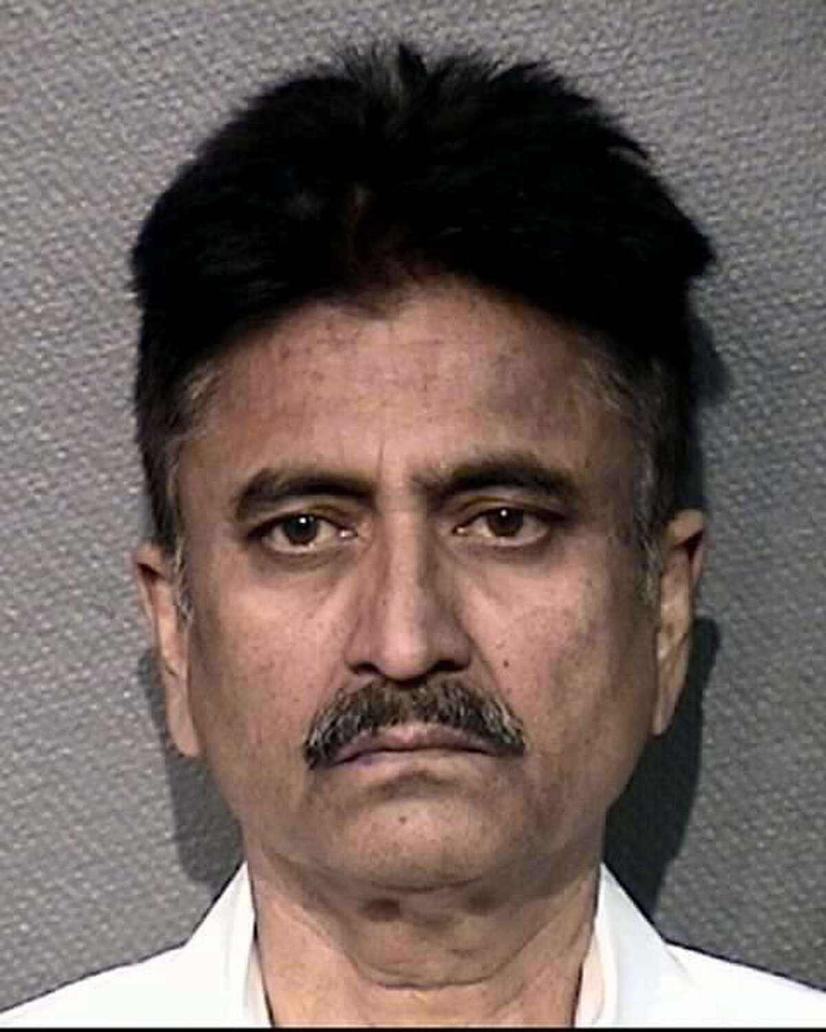 HPD Senior Officer Muzaffar Siddiqi, 56, has been charged with DWI after an incident on Monday, Dec. 17, 2018, police said.