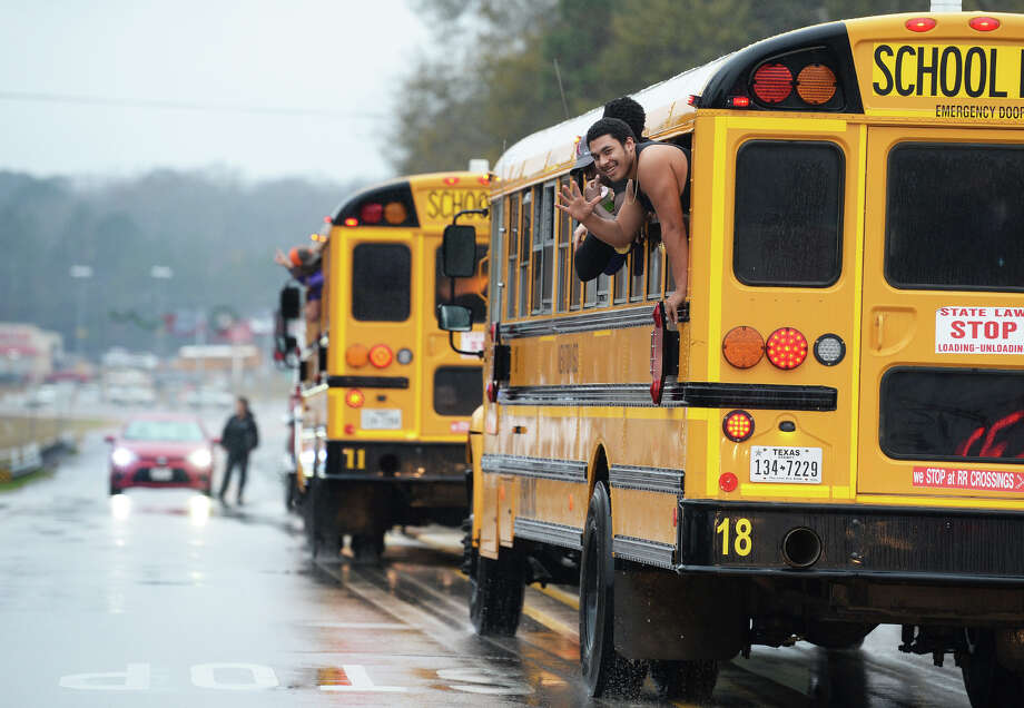 Newton football players revel at fans while driving past the Newton County Courthouse on their way to the state finals in Dallas. The Eagles play Canadian High School Thursday at 3 p.m. Photo taken Wednesday, 12/19/18 Photo: Guiseppe Barranco/The Enterprise / Guiseppe Barranco ?