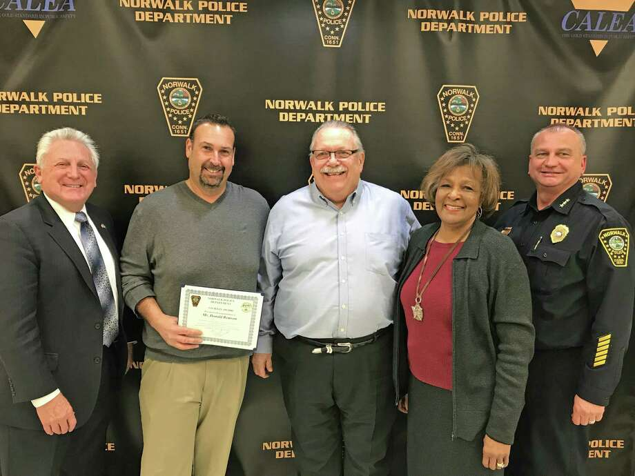 Juan Garcia and Donald Remson received a Civilian Recognition Award from the Norwalk Police Commission. They stopped a woman from jumping from the Stroffolino Bridge. Photo: Contributed / Norwalk Poilce Department