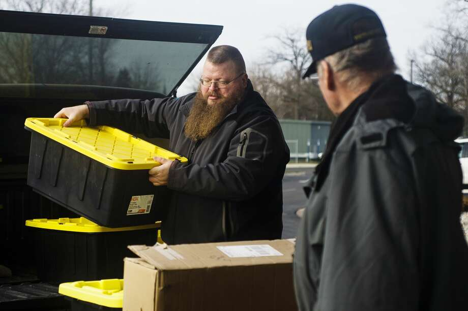 Great Lakes Bay Veterans Coalition Director Brad Blanchard loads bins filled with donated toiletries onto a cart as the items are donated to the Aleda E. Lutz VA Medical Center in Saginaw on Wednesday morning, Dec. 19, 2018. (Katy Kildee/kkildee@mdn.net) Photo: (Katy Kildee/kkildee@mdn.net)