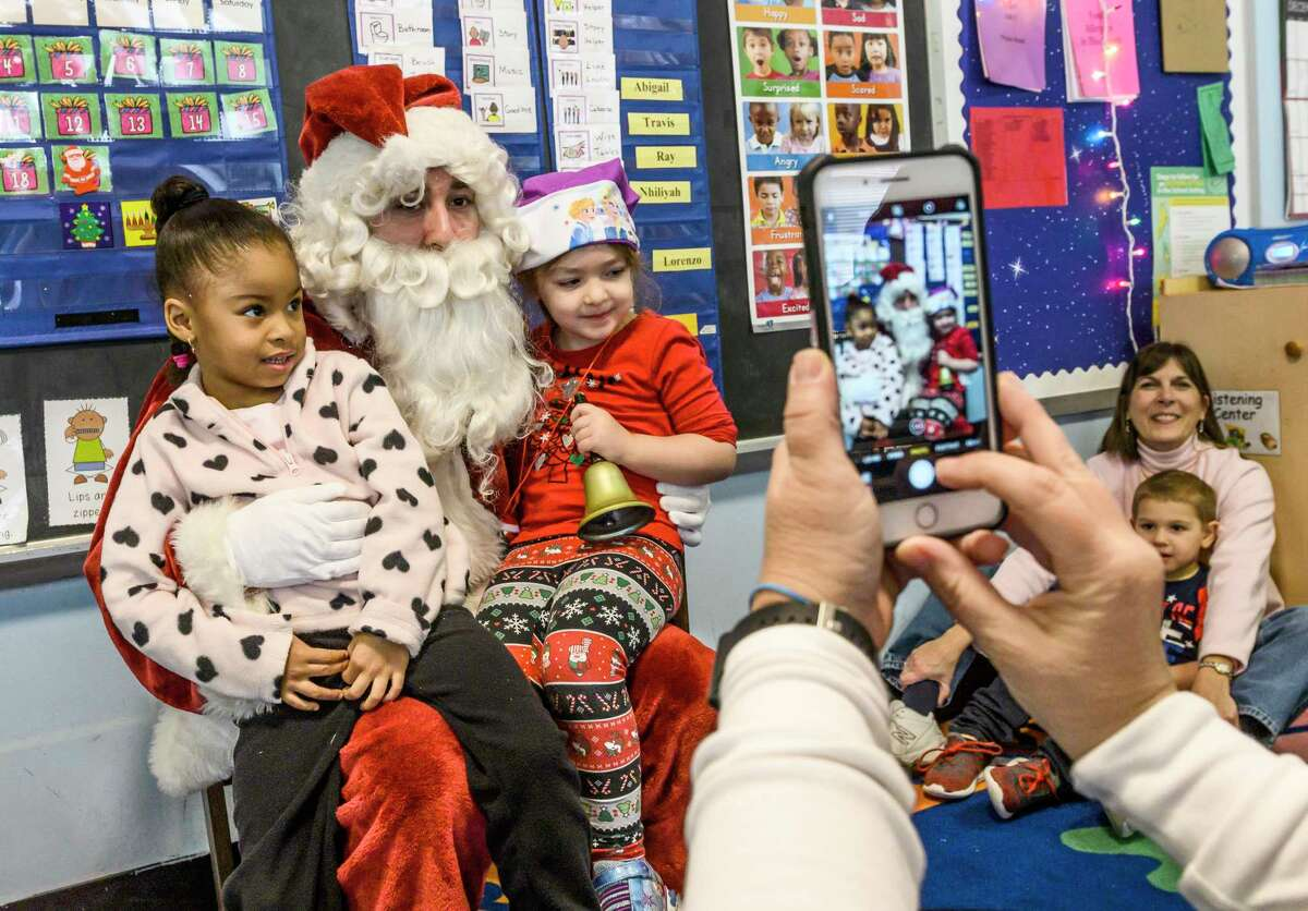 Santa a.k.a Rafael Levy-Lesko has a photo op as he makes a visit to teacher Jami Sousis' Pre School Class at A Child's Place, Unity House Wednesday Dec. 18, 2018 in Troyi, N.Y. (Skip Dickstein/Times Union)
