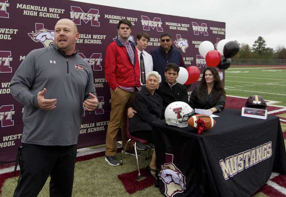 Magnolia West head coach JD Berna talks about tight end Simon Gonzalez before signing to play football for Texas Tech during a signing day ceremony at Magnolia West High School, Wednesday, Dec. 19, 2018, in Magnolia. Photo: Jason Fochtman, Houston Chronicle / Staff Photographer / © 2018 Houston Chronicle